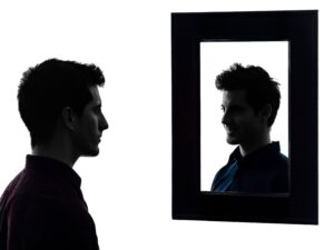 Personality Disorders from a Man looking at his reflection for Psychoanalytic Perspective