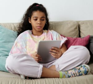 Adolescent girl with tablet